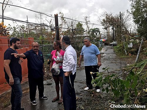 Talking to locals and workers to see where help is needed.