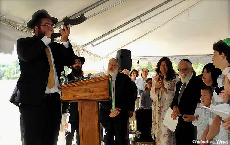 Rabbi Yisroel Freeman, co-director of the Chabad Center of Sudbury, blows the shofar at the Sept. 10 grand-opening ceremony of a new 5,000-square-foot building.