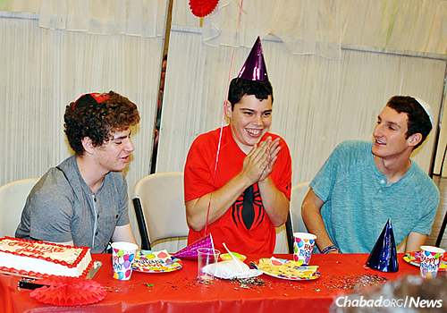 A teen with special needs celebrates his birthday at Friendship Circle with his peers. (Photo: Friendship Circle of Los Angeles)