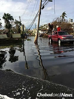 Many roads remain flooded island-wide, complicating deliveries of goods.