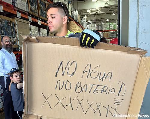 """No water, no batteries"" reads a handmade sign outside of a local supply store."