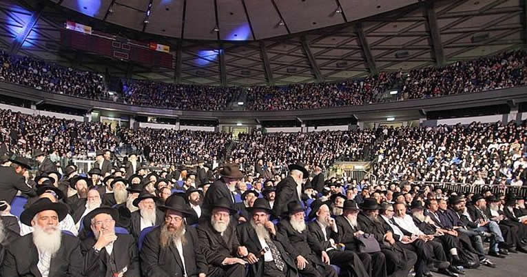 From homes to synagogues to vast arenas like the one above in Israel, gatherings around the world mark the completion of the annual study of Maimonides' Mishneh Torah. (File photo)