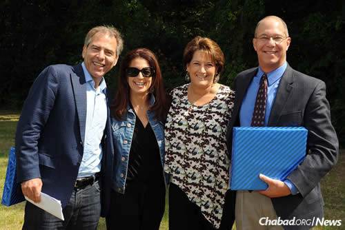 Community members Rick and Gabrielle Henken, left, and Jill and Charles Katz