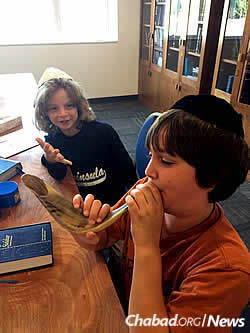 Students on the first day of Hebrew school get ready for Rosh Hashanah.