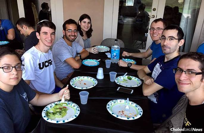 Many students sheltered and fed by Chabad on Campus centers in Florida during Hurricane Irma are out in communities helping others. During the storm, Jesse Slomowitz, bottom right, stayed at Chabad at the University of Central Florida in Oviedo, just outside of Orlando, and ate meals there afterwards with others.