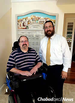 The rabbi with management consultant Mark Rosen, now active with Chabad