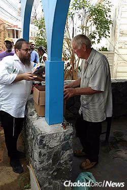 Bringing kosher food to Jewish residents who remain on St. Thomas.