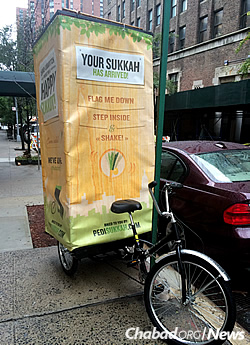 A pedi-sukkah meets neighborhood needs. (Photo: Howard Blas)