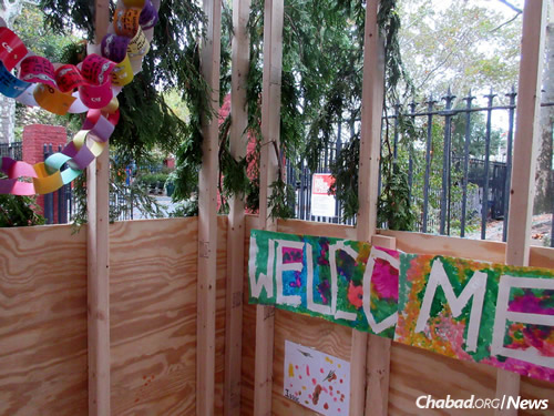 """Welcome"" to the 77th Street sukkah (Photo: Howard Blas)"