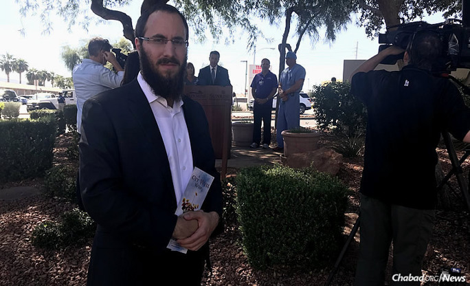 Rabbi Levi Harlig, who directs Chabad of Las Vegas Blvd. with his twin brother, Rabbi Mordechai Harlig, led Nevada Gov. Brian Sandoval in prayer before a press conference on Monday after a mass shooting at a Las Vegas music concert led to the deaths of 59 people.