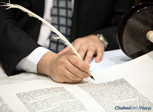 "Inscribing the final word, ""Israel,"" referring to the Jewish people (Photo: Andrew Taylor)"
