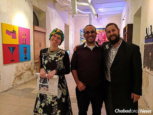 """Moully, right, with Noa Leah Cohen, curator of """"Popthodox,"""" and Rami Ozeri, founder and director of the Jerusalem Biennale, a once-every-two-years' exhibition."""