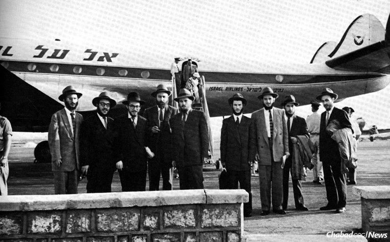 The yeshivah students (nine of the 12 seen here) chosen as the Rebbe's representatives arrived in the Lod airport on July 13, 1956, remaining in Israel for 28 days. From left: Rabbis Zushe Posner, Sholom Ber Butman, Sholom Ber Shemtov, Dovid Schochet, Yosef Rosenfeld, Sholom Eidelman, Faivel Rimler, Shlomo Kirsh and Yehuda Krinsky. (Photo courtesy of Kehot Publication Society)