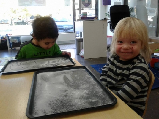 Finger drawings on a salty tray allow us to explore sense of touch and taste!