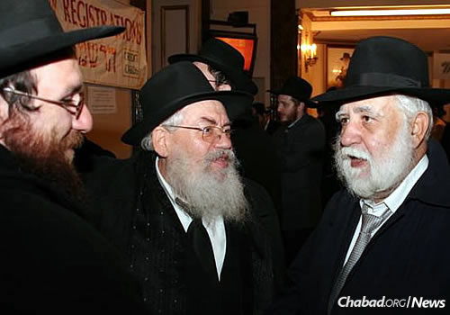 Hadad speaks with Rabbi Shimon Lazaroff, center, head Chabad emissary of Texas. (Photo: Chabad.Italia)