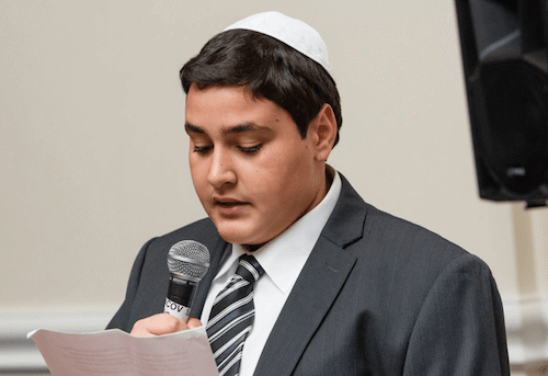 A Bar Mitzvah boy giving a speech (Serraf Studio)