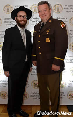 Tenenbaum, left, with Maryland State Police superintendent Col. William Pallozzi