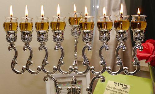 A Chanukah menorah on the eighth night, using oil.