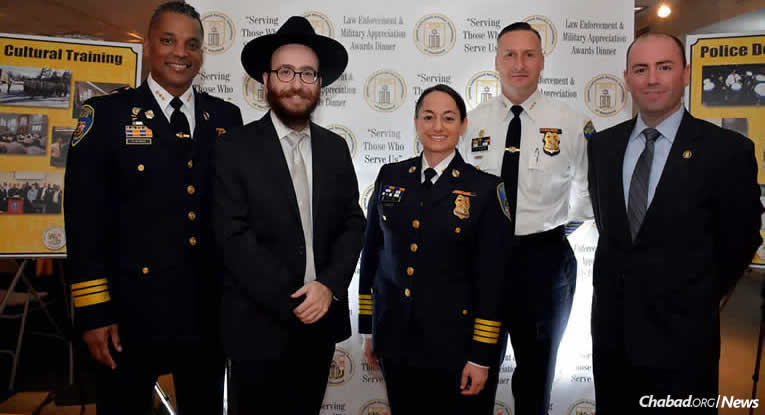 At the inaugural Jewish Uniformed Service Association of Maryland (JUSA) Law Enforcement and Military Appreciation Awards Dinner honoring Jewish police, fire and military members are, from left: Baltimore Police Deputy Commissioner Darryl Desousa, Rabbi Chesky Tenenbaum, Baltimore Police Department Chief Melissa Hyatt, Baltimore Police Deputy Commissioner Dean Palmere and Baltimore Police Detective Jeremy Silbert.