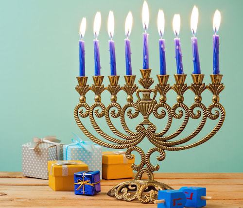 A Chanukah menorah on the eighth night, lit with candles.