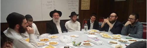 A farbrengen (Chassidic gathering) with Rabbi Brafman (center)