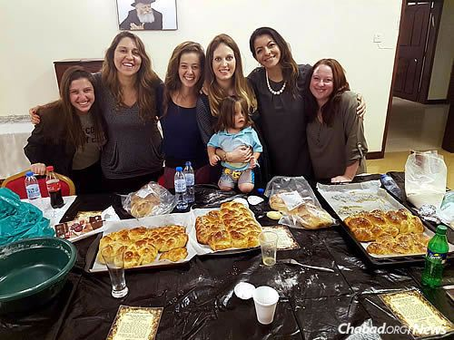 Yocheved Raskin, fourth from left, is organizing challah-making workshops and other programs for women.