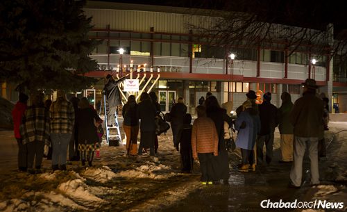 Rabbi Yonah Grossman leads the menorah-lighting in front of the Fargo Civic Center.