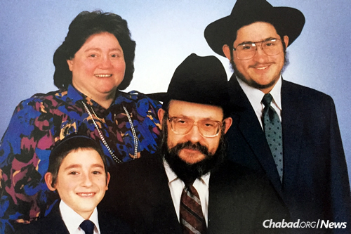 Mindelle Feller with her husband, Rabbi Moshe Feller, and their sons, Rabbi Mendel Feller and Levi Feller, circa 1990.