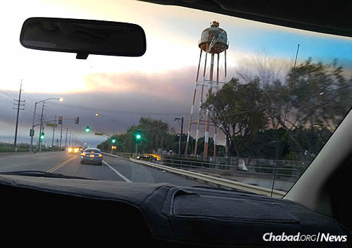 On the way to deliver items; the darkening skies from the fires can be seen ahead.