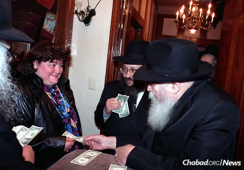 Receiving a dollar from the Lubavitcher Rebbe—Rabbi Menachem M. Schneerson, of righteous memory.