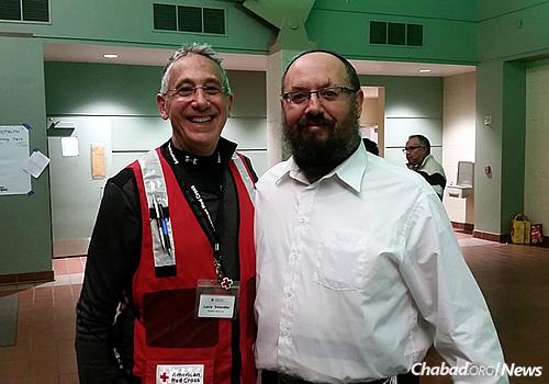 Rabbi Yakov Latowicz, center, director of Chabad of Ventura, with Red Cross volunteer Larry Swerdlin