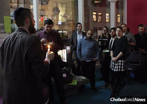 """We wanted to show that hidden within plain sight is the potential for a lot of light and a lot of revelation,"" says Rabbi Mordechai Lightstone, shown leading a prior Chanukah event."
