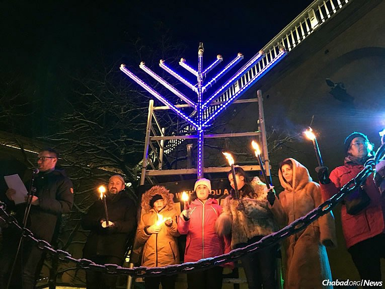 The event in Gothenburg, attended by the city's mayor, Ann-Sofie Hermansson, took place just days after a local synagogue was firebombed. Here, eight community members form a human menorah, spreading light and a positive Jewish message to the world.