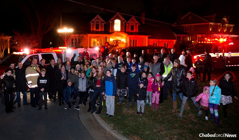 Hundreds of people joined in a procession of fire trucks, police cars and EMS ambulances as part of a Chanukah parade organized by Chabad of Upper Montgomery County in Gaithersburg, Md., and the Rockville Volunteer Fire Department. The event, complete with a menorah-lighting, honored the area's first responders, including a Jewish volunteer who died last week. (Photo: David Hartzman)