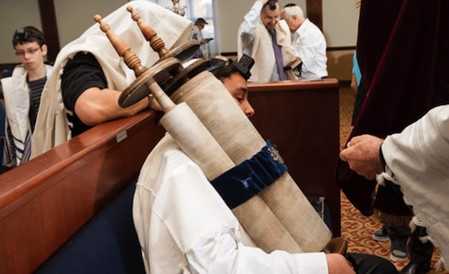 The Torah is bound tight with the gartel (sash).
