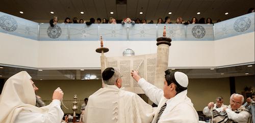 Raising the Torah, called hagbah (Credit: Serraf Studio)