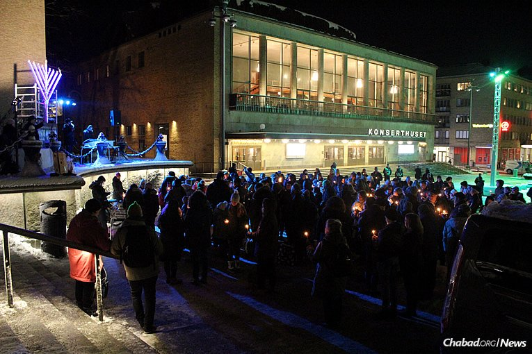 Gathering together in Gothenburg, Sweden, to light the menorah on Tuesday, Dec. 12, the first night of the eight-day holiday of Chanukah.