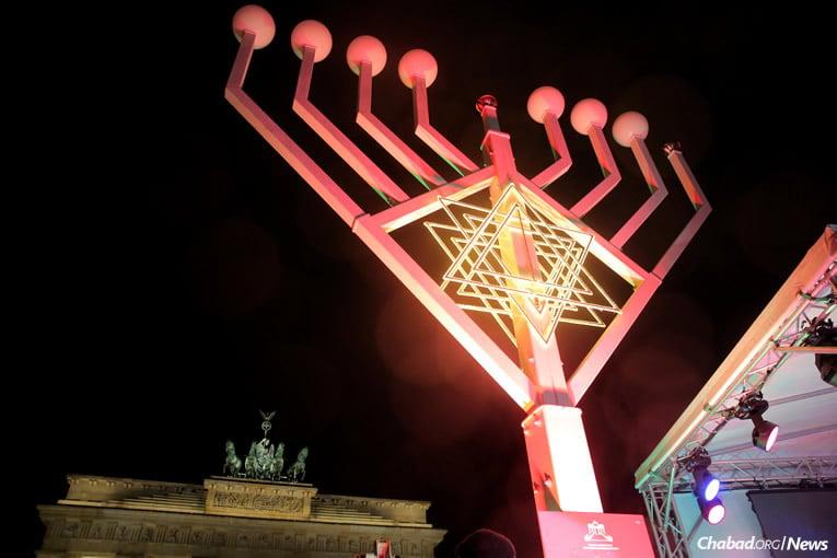 Light illuminates the night in front of the Brandenburg Gate in Berlin, Germany.
