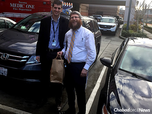 Heber brings kosher food to a Jewish member of the Amtrak response team in Tacoma.