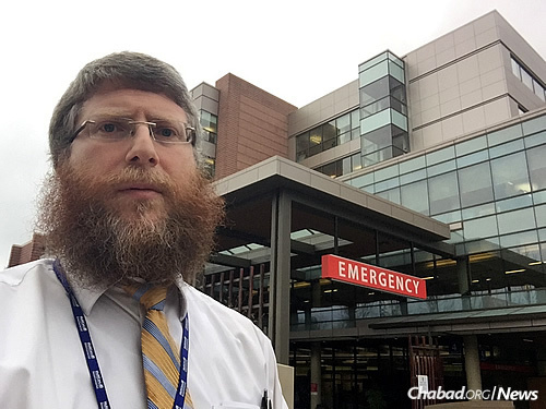 Rabbi Zalman Heber, a chaplain and co-director of Chabad of Pierce County in Tacoma, Wash., in front of Tacoma General Hospital, where he visited the emergency room and waiting areas, talking to families of passengers being treated.