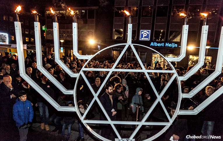 People of all ages from across Amsterdam celebrated Chanukah at a Sunday-night menorah-lighting that expressed appreciation for the city's police force and Dutch military for their work in keeping the Jewish community safe. (Photo: DPHOTO/Dirk P.H. Spits)
