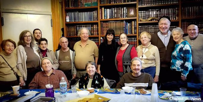 """""""Senior Kluger Club"""": A group of older men and women come to Chabad of Brooklyn Heights, N.Y., once a month to participate in a Jewish educational program or activity. Some of them also receive weekly """"Stoop Soup"""" kosher care packages."""