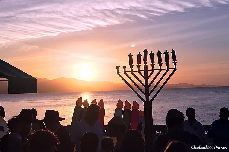 Chabad of Jamaica brought out local residents and tourists to a celebration that featured the kindling of an 8-foot-tall bamboo menorah.