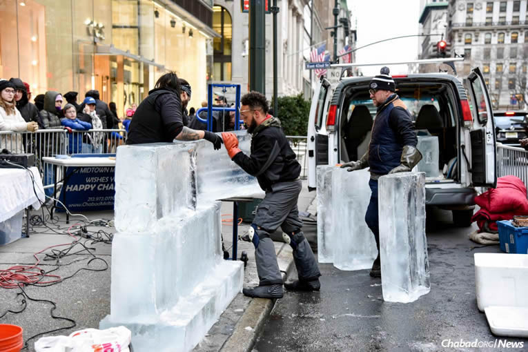 Assembling the Chanukah ice menorah sponsored by Chabad Lubavitch of Midtown Manhattan.
