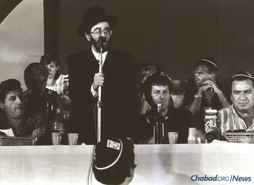 Addressing attendees at a function in Israel