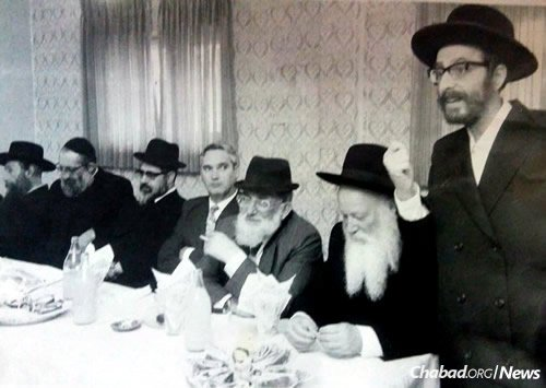 Slonim speaks at a meeting that included the late Rabbi Ovadia Yosef, fifth from left, the Sephardi Chief Rabbi of Israel from 1973 to 1983.