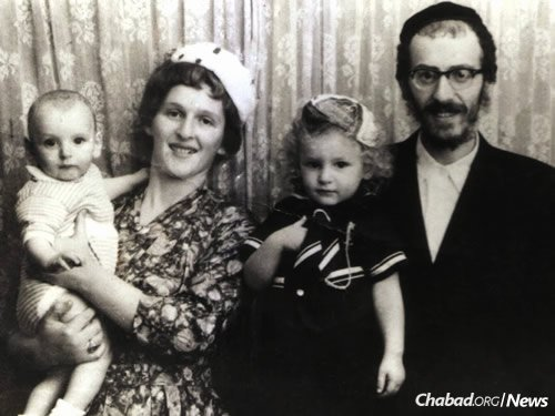 With his wife, Gitel Leah, and two of their children