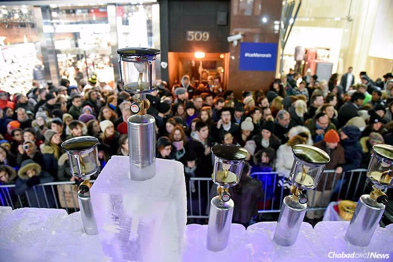 Huge crowds came for the lighting of the ice menorah in Midtown Manhattan, where some 600 doughnuts and 900 latkes were also served.