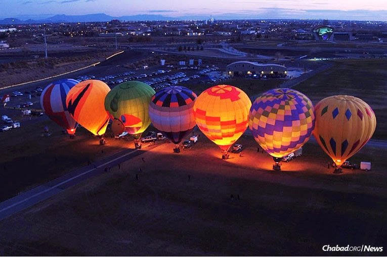 """It was high flying as Chabad of New Mexico in Albuquerque held a """"Chanukah Night Glow"""" event on Dec. 17, where hot-air balloons formed a rather unusual, though stunningly beautiful, menorah in the sky."""