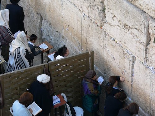 At the Western Wall Plaza, the mechitzah divides the thousands of male and female worshippers who stream to the sacred spot at all times of night and day.
